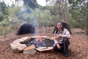 Noongar woman at the firepit