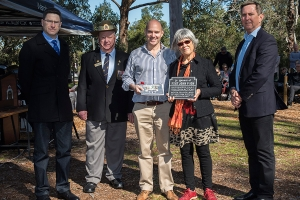 Bronwyn Goss accepting the plaque as the niece of Flight Sergeant John P. Ion. Photo: D. Nicolson.