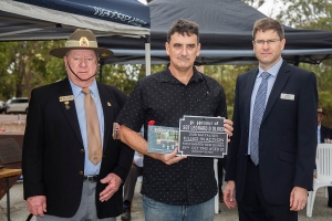 Jason Oliver accepting the plaque as the grandson of Sergeant Leonard D. Oliver. Photo: D. Nicolson.