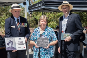 Shirley Ward and Kevin Anthony accepting the plaque as the grand niece and great nephew of Private Charles McP. Anthony. Photo: D. Nicolson.