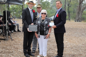 June Graham accepting the plaque as the daughter of Private Eric Gordon Brown. Photo: D. Nicolson.