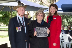 Nicolie Collinson accepting the plaque as the niece of Private Harold A. Walker. Photo: D. Nicolson.