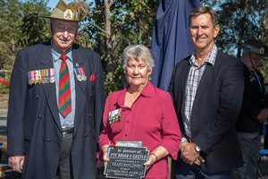 Dawn Woolhead accepting the plaque as the sister of Private Brian E. Castle. Photo: D. Nicolson.