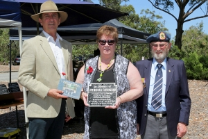 Collen Cole accepting the plaque as the grand daughter of Sapper Michael Cunningham. Photo: D. Nicolson.