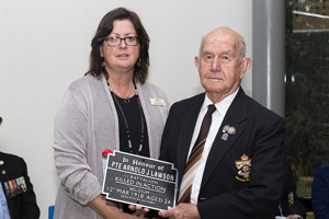 Bill Mitchell accepting the plaque as the Great Nephew of Private Arnold J. Lawson. Photo: D. Nicolson.