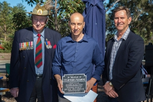 Glenn Bugess accepting the plaque as the Great Great Nephew of Private Arthur C. Passmore. Photo: D. Nicolson.