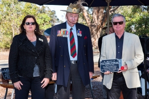Peter Brown accepting the plaque as the Grandson of Private Frank Spencer. Photo: D. Nicolson.